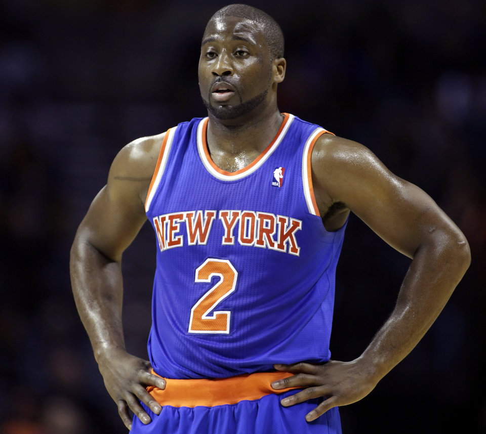 In this Friday, Nov. 8, 2013 photo, New York Knicks guard Raymond Felton catches his breath during a break in the action in an NBA basketball game against the Charlotte Bobcats, in Charlotte, N.C. New York police say Felton has been arrested on three counts of criminal possession of a weapon. Sgt. Thomas Antonetti says Felton turned himself in at 12:50 a.m., Tuesday, Feb. 25, 2014, and was questioned in the 20th Precinct in Manhattan, hours after his team lost at home to the Dallas Mavericks. (AP Photo/Nell Redmond)