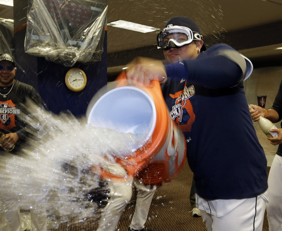Photo -   Detroit Tigers' Miguel Cabrera celebrates in the locker room after his team won Game 4 of the American League championship series 8-1, against the New York Yankees, Thursday, Oct. 18, 2012, in Detroit. The Tigers move on to the World Series. (AP Photo/Paul Sancya )