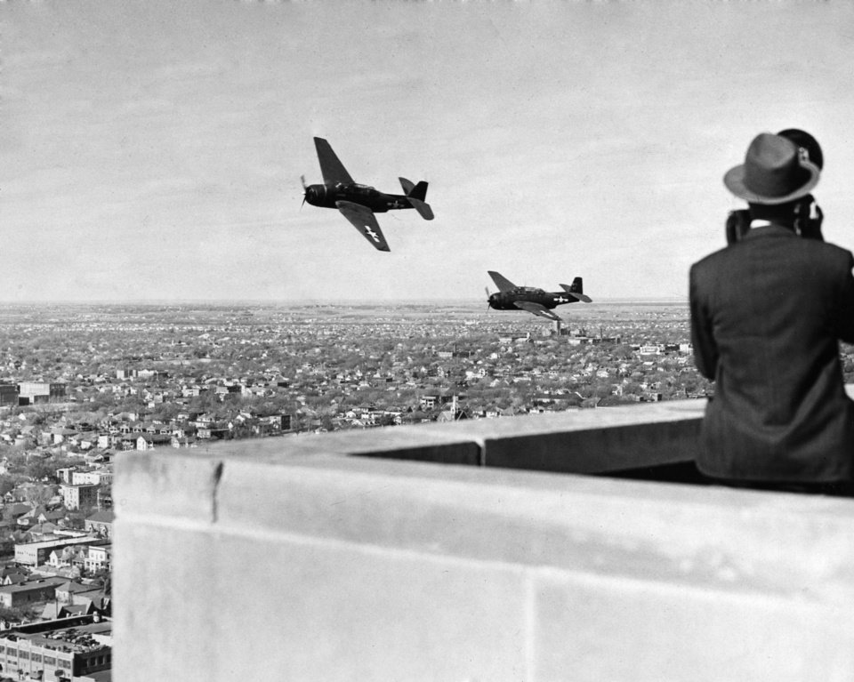 OKLAHOMA CITY / SKY LINE / OKLAHOMA / AERIAL VIEWS / AERIAL PHOTOGRAPHY / AIR VIEWS: Don\'t Drop In... No, customers, this Corsair pilot was not just dropping in to pay a utility bill. He was just giving office workers on