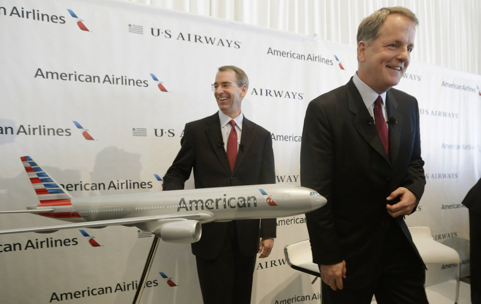 U.S. Airways CEO Doug Parker, right, and American Airlines CEO Tom Horton conclude a news conference at DFW International Airport Thursday, Feb. 14, 2013, in Grapevine, Texas. The two airlines will merge forming the world's largest airlines.  (AP Photo/LM Otero)