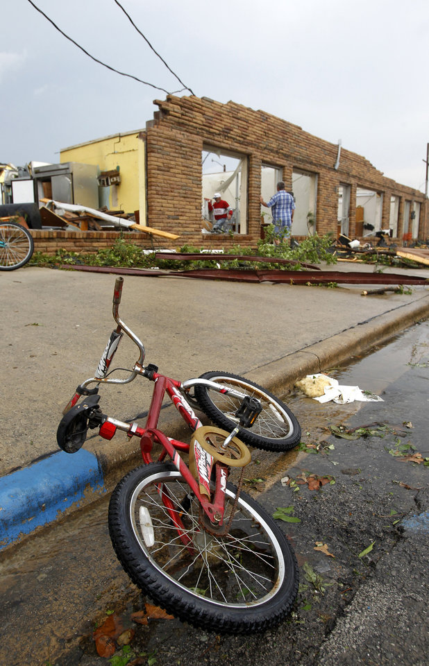 Photo - People search for belongings in a law firm after a tornado hit downtown Culman, Ala., on Wednesday, April 27, 2011. (AP Photo/Butch Dill)