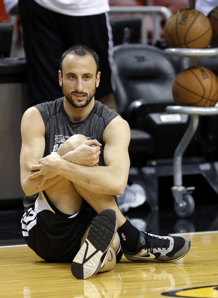 Photo - San Antonio Spurs shooting guard Manu Ginobili, of Argentina, stretches during NBA basketball practice, Wednesday, June 19, 2013, at the American Airlines Arena in Miami. The Spurs take on the Miami Heat in Game 7 of the NBA Finals on Thursday in Miami. (AP Photo/Wilfredo Lee)