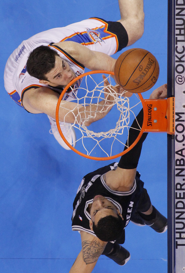 Oklahoma City\'s Nick Collison (4) battles under the basket with San Antonio\'s Danny Green (4) during Game 6 of the Western Conference Finals between the Oklahoma City Thunder and the San Antonio Spurs in the NBA playoffs at the Chesapeake Energy Arena in Oklahoma City, Wednesday, June 6, 2012. Photo by Chris Landsberger, The Oklahoman