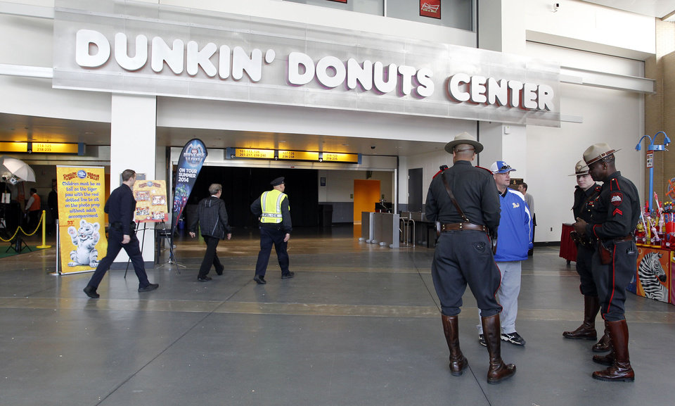 Photo - Rhode Island state troopers and Providence police stand in the lobby of the Dunkin' Donuts Center after an accident during the Ringling Bros. and Barnum & Bailey Circus performance, Sunday, May 4, 2014, in Providence, R.I.  A platform collapsed during an aerial hair-hanging stunt at the 11 a.m. performance Sunday, sending eight acrobats plummeting to the ground. At least nine performers were seriously injured in the fall, including a dancer below, while an unknown number of others suffered minor injuries. (AP Photo/Stew Milne)
