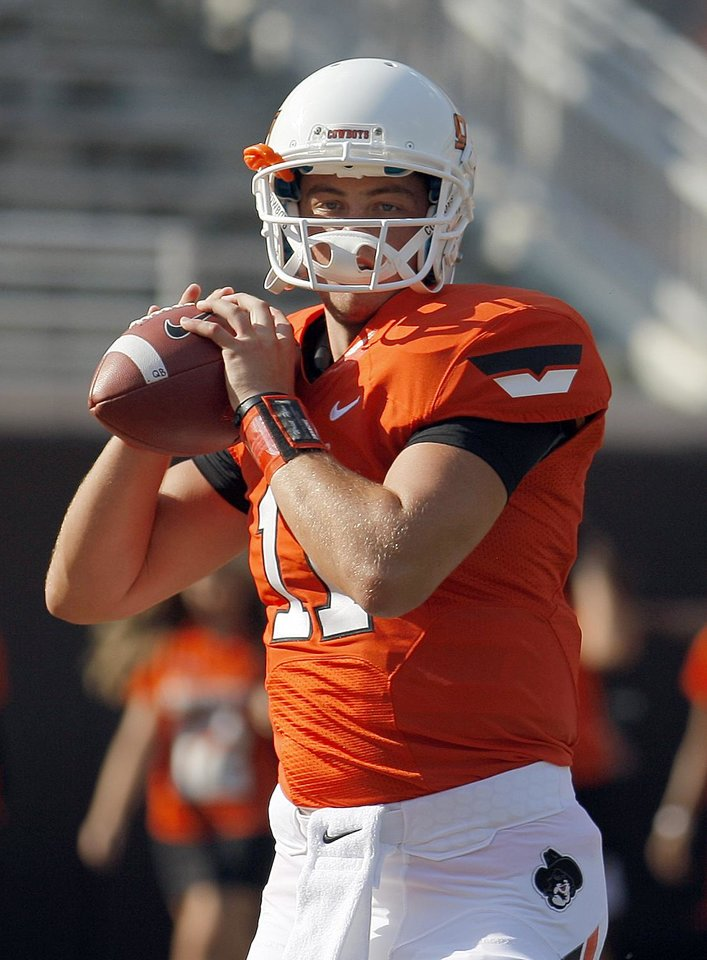 Photo - Oklahoma State's Wes Lunt (11) warms up before during a college football game between Oklahoma State University (OSU) and Savannah State University at Boone Pickens Stadium in Stillwater, Okla., Saturday, Sept. 1, 2012. Photo by Sarah Phipps, The Oklahoman