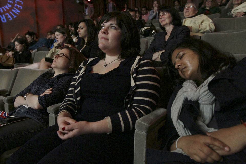 Photo - As her friends sleep on each side of her, Kristin DiQuollo of Brooklyn, N.Y., watches a live broadcast of the wedding of Prince William and Kate Middleton during the Paley Center's Royal Wedding Viewing Party in New York Friday April 29, 2011. (AP Photo/Tina Fineberg) ORG XMIT: NYTF106
