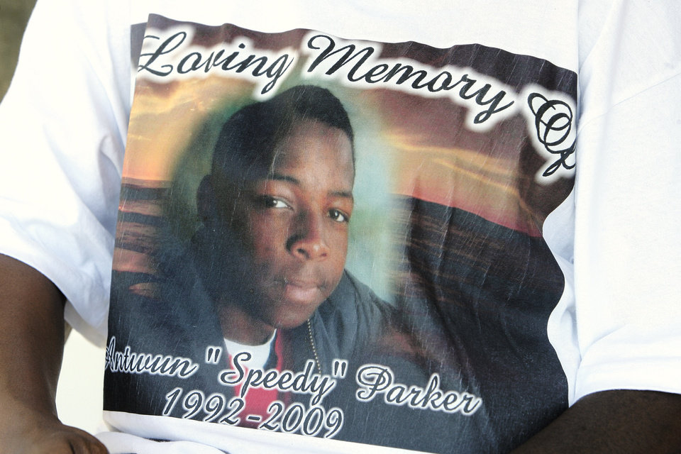Photo - Antwun Parker's photo on the shirt of Sheila Osborn, Antwun's aunt, in Oklahoma City Friday, May 29, 2009. Parker, 16, was killed by pharmacist Jerome Jay Ersland during an attempted robbery of Reliable Discount Pharmacy, 5900 S Pennsylvania Ave, on May 19, 2009. Photo by Paul B. Southerland, The Oklahoman