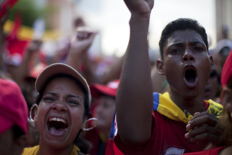 Supporters of Venezuela's President Hugo Chavez cheer during a campaign rally in Valencia, Venezuela, Wednesday, Oct. 3, 2012. Chavez is running for re-election against opposition candidate Henrique Capriles in presidential elections on Oct . 7. (AP Photo/Rodrigo Abd)