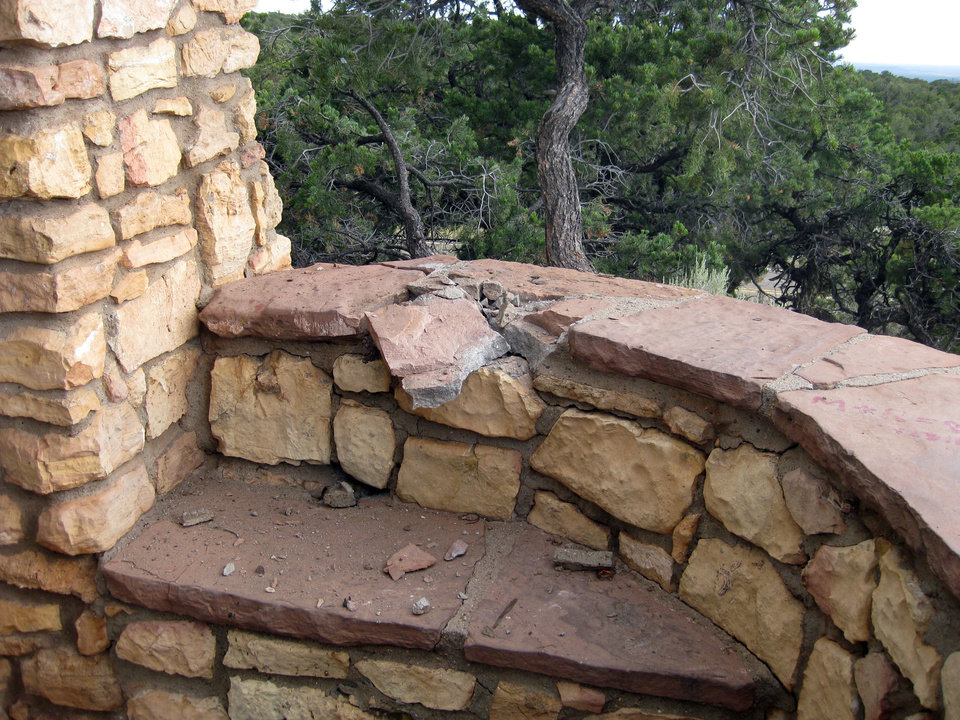 Photo - This Wednesday, July 24, 2013 photo provided by the Coconino County Sheriff's Office shows the rock wall believed to be where a victim was sitting when lighting stuck Tuesday at the Le Fevre Overlook on Highway 89A, some 8 miles north of Jacobs Lake, Ariz. A married couple was killed and a teenage boy injured when the lightning struck, authorities said Wednesday. (AP Photo/Coconino County Sheriff's Office)