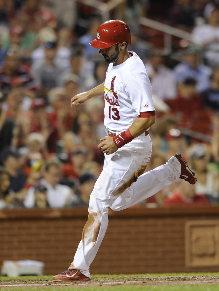 Photo - St. Louis Cardinals' Matt Carpenter (13) scores on an RBI double by teammate Matt Adams against the Boston Red Sox in the first inning in a baseball game, Wednesday, Aug. 6, 2014, at Busch Stadium in St. Louis. (AP Photo/Bill Boyce)