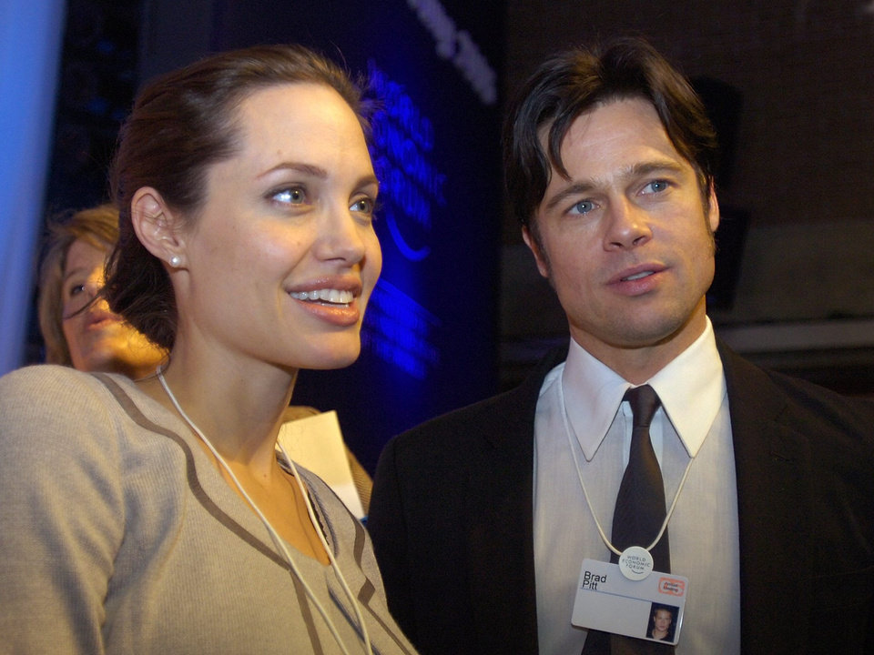 Photo - FILE - In this Thursday, Jan. 26, 2006, file photo, Angelina Jolie, left, and Brad Pitt attend the World Economic Forum in Davos, Switzerland. Jolie and Pitt were married Saturday, Aug. 23, 2014, in France, according to a spokesman for the couple. (AP Photo/Keystone, Walter Bieri, File)