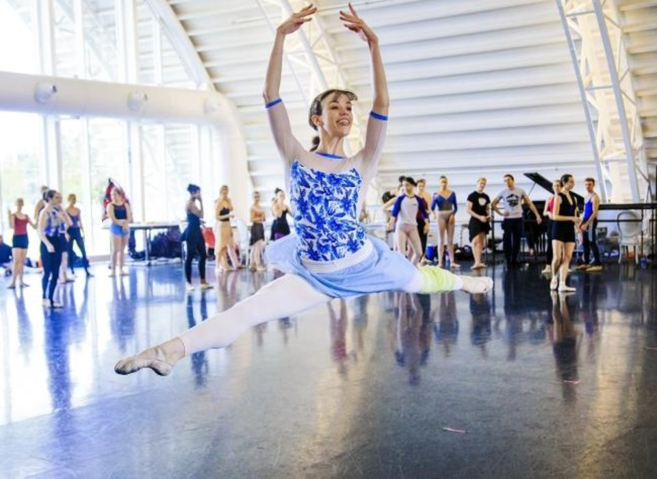 Photo -  Oklahoma City Ballet dancer Carrie Ruth Trumbo leaps during rehearsals for the Oklahoma City Ballet's production of