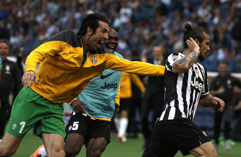Photo - Juventus forward Pablo Daniel Osvaldo, right, celebrates after scoring with Juventus goalkeeper Gianluigi Buffon during an Italian Serie A soccer match between Roma and Juventus at Rome's Olympic stadium, Sunday, May 11, 2014. Juventus won 1 - 0. (AP Photo/Alessandra Tarantino)