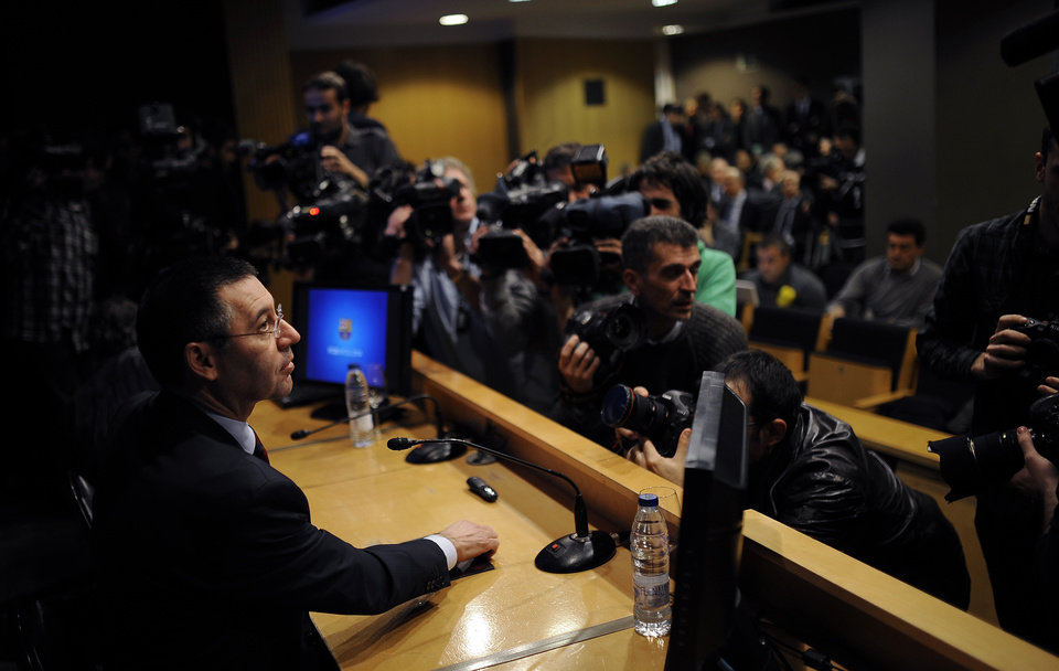 Photo - FC Barcelona's President Josep Maria Bartomeu attends a press conference at the Camp Nou stadium in Barcelona, Spain, Friday, Jan 24, 2014. Barcelona says its board of directors is calling an ''extraordinary'' meeting, fueling Spanish media reports that club president Sandro Rosell is under pressure to consider stepping down due to the lawsuit regarding Neymar's transfer. Barcelona said in a statement that the meeting will take place on Thursday afternoon, a day after a judge agreed to hear a lawsuit brought by a Barcelona club member over the cost of Neymar's signing. (AP Photo/Manu Fernandez)