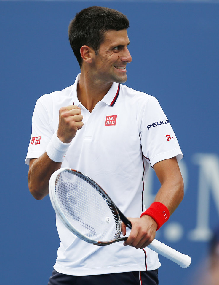 Photo - Novak Djokovic, of Serbia, reacts to his box after a shot against Sam Querrey, of the United States, during the third round of the 2014 U.S. Open tennis tournament, Saturday, Aug. 30, 2014, in New York. (AP Photo/Matt Rourke)