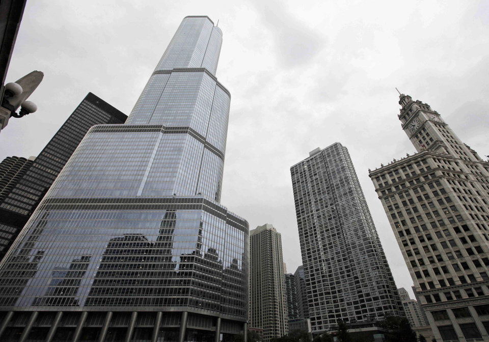 Photo - FILE -This Aug. 23, 2012 file photo, shows the Trump International Hotel & Tower, left, in downtown Chicago. On Thursday, May 23, 2013, jurors went into their second day of deliberations at a civil trial in Chicago where  Jacqueline Goldberg, 87, is alleging Donald Trump cheated her in a condominium deal. Goldberg is seeking damages totaling around $6 million. If jurors decide Trump defrauded Goldberg, they'll have to decide how much money to award her. (AP Photo/M. Spencer Green, File)