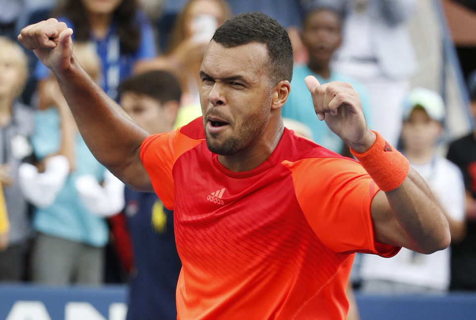 Photo - Jo-Wilifried Tsonga, of France, reacts after defeating Pablo Carreno Busta, of Spain, during the third round of the 2014 U.S. Open tennis tournament, Saturday, Aug. 30, 2014, in New York. (AP Photo/Kathy Willens)