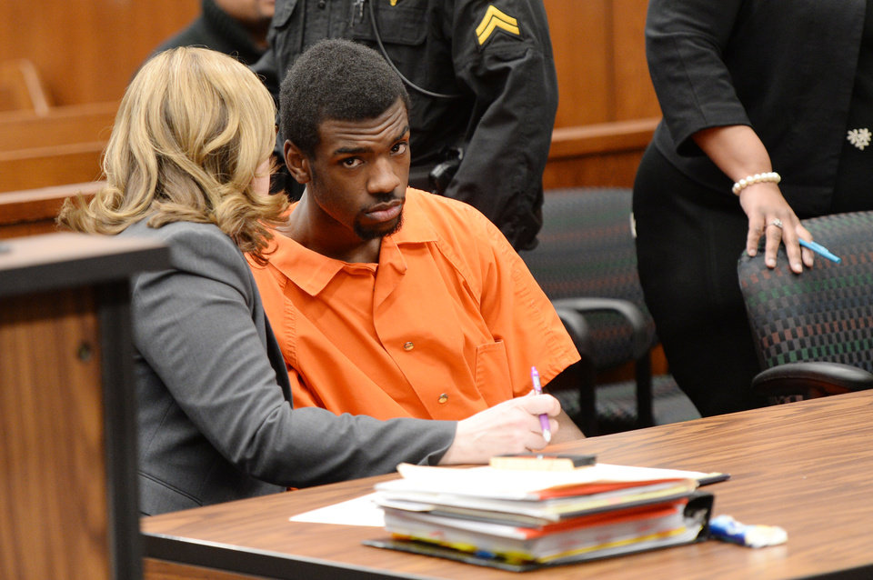 Photo - Ed Thomas, of Detroit, suspected in the death of Eastern Michigan student and football player Demarius Reed listens to his attorney Gina Noveskey, during a preliminary exam in the 14A-1 district court in Pittsfield Township, Mich., on Wednesday, Jan. 29, 2014. The exam was postponed until February, 3 at 2:30 p.m. Melanie Maxwell | The Ann Arbor News(AP Photo/The Ann Arbor News, Melanie Maxwell)