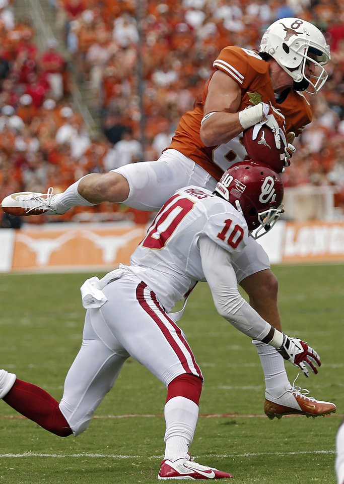 UT's Jaxon Shipley (8) makes a catch over OU's Quentin Hayes (10) during the Red River Rivalry college football game between the University of Oklahoma Sooners (OU) and the University of Texas Longhorns (UT) at the Cotton Bowl Stadium in Dallas, Saturday, Oct. 12, 2013. Photo by Chris Landsberger, The Oklahoman