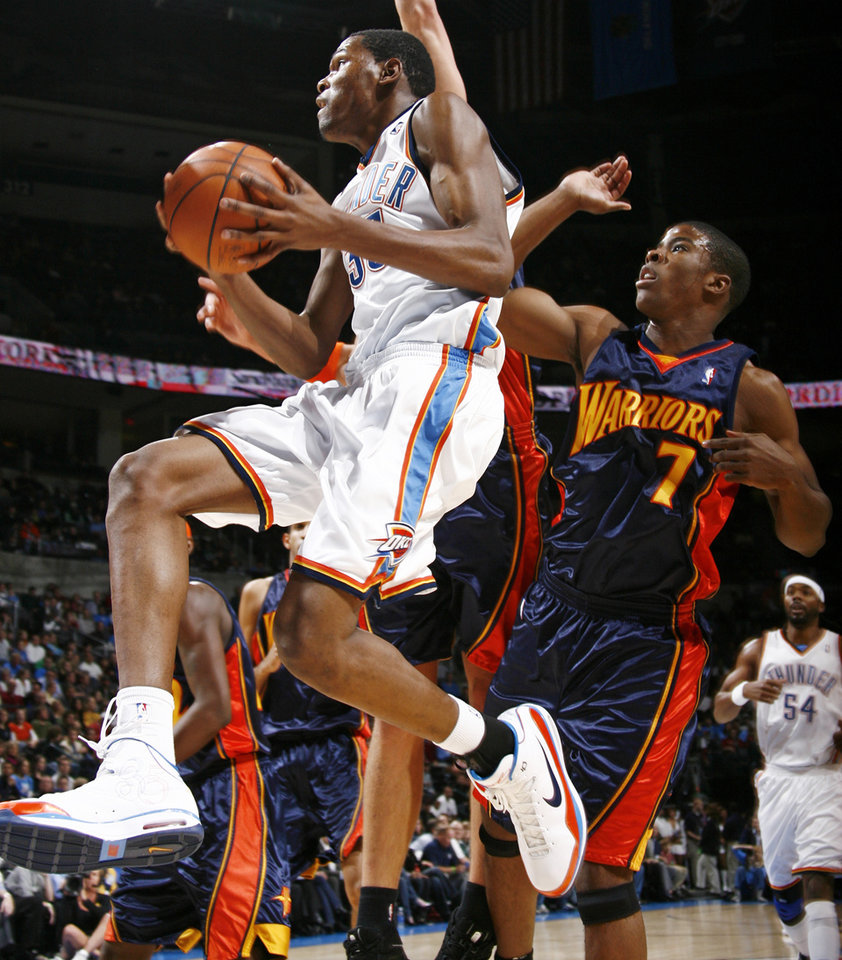 Oklahoma City's Kevin Durant moves to the hoop past Kelenna Azubuike of Golden State in the first half during the NBA basketball game between the Golden State Warriors and the Oklahoma City Thunder at the Ford Center in Oklahoma City, Monday, December 8, 2008. BY NATE BILLINGS, THE OKLAHOMAN