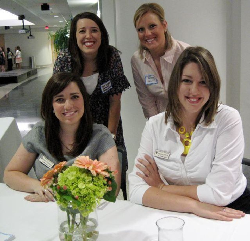 PANHELLENIC BRUNCH/VINTAGE FASHIONS...Connie Turmelle, Jordan Eppler,   front, and Claire Turmelle and Kaitlin Hornbostel, back check in   guests at the University of Oklahoma Panhellenic Association brunch celebrating a century of sisterhood.  The event was at the National Weather Center and was one of the events during the 100 anniversary week-end. (Photo by Helen Ford Wallace).