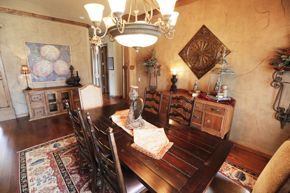 Photo - The dining room of Denise Patterson's home at 18270 N Antler Way in the Deer Creek area. Photos by Steve Gooch, The Oklahoman