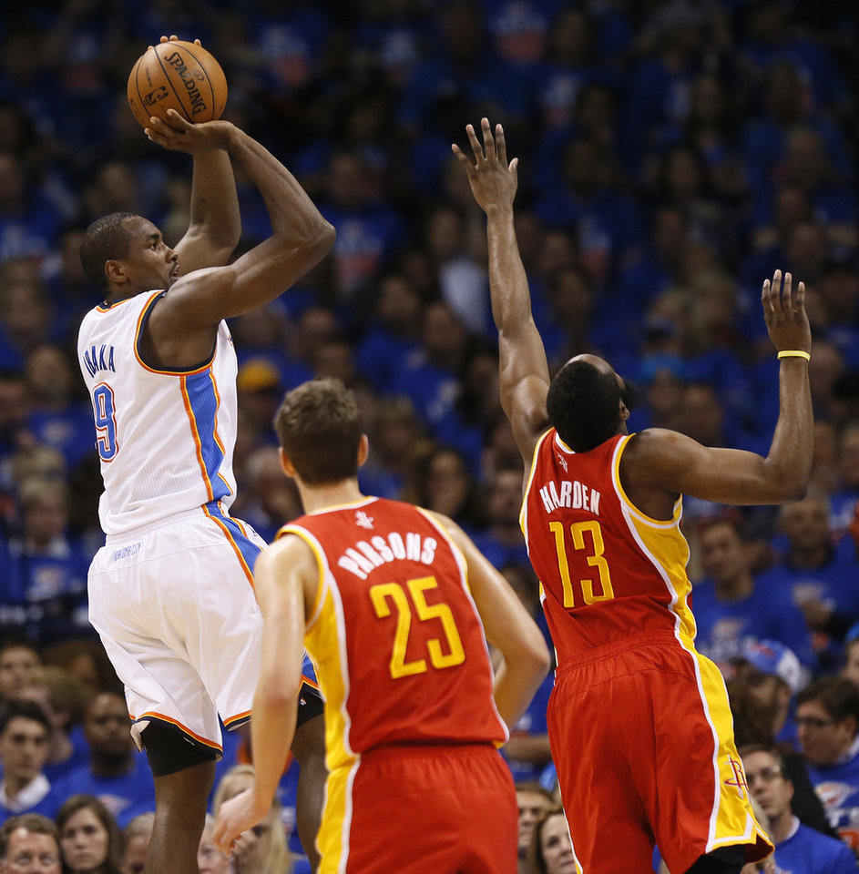 Photo - Oklahoma City's Serge Ibaka (9) shoots against Houston's Chandler Parsons (25) and James Harden (13) in the first half during Game 5 in the first round of the NBA playoffs between the Oklahoma City Thunder and the Houston Rockets at Chesapeake Energy Arena in Oklahoma City, Wednesday, May 1, 2013. Photo by Nate Billings, The Oklahoman