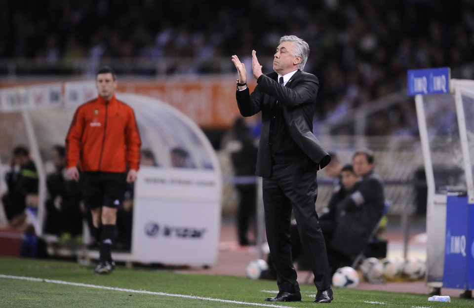 Photo - Real Madrid's head coach Carlo Ancelotti of Italy, applauds his team after scoring the fourth goal against Real Sociedad, during their Spanish League soccer match, at Anoeta stadium, in San Sebastian, Spain, Saturday, April 5, 2014. (AP Photo/Alvaro Barrientos)