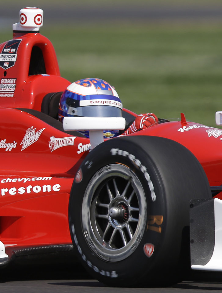 Photo - Scott Dixon, of New Zealand, drives through turn 13 during practice for the inaugural Grand Prix of Indianapolis IndyCar auto race at the Indianapolis Motor Speedway in Indianapolis, Thursday, May 8, 2014. (AP Photo/Michael Conroy)