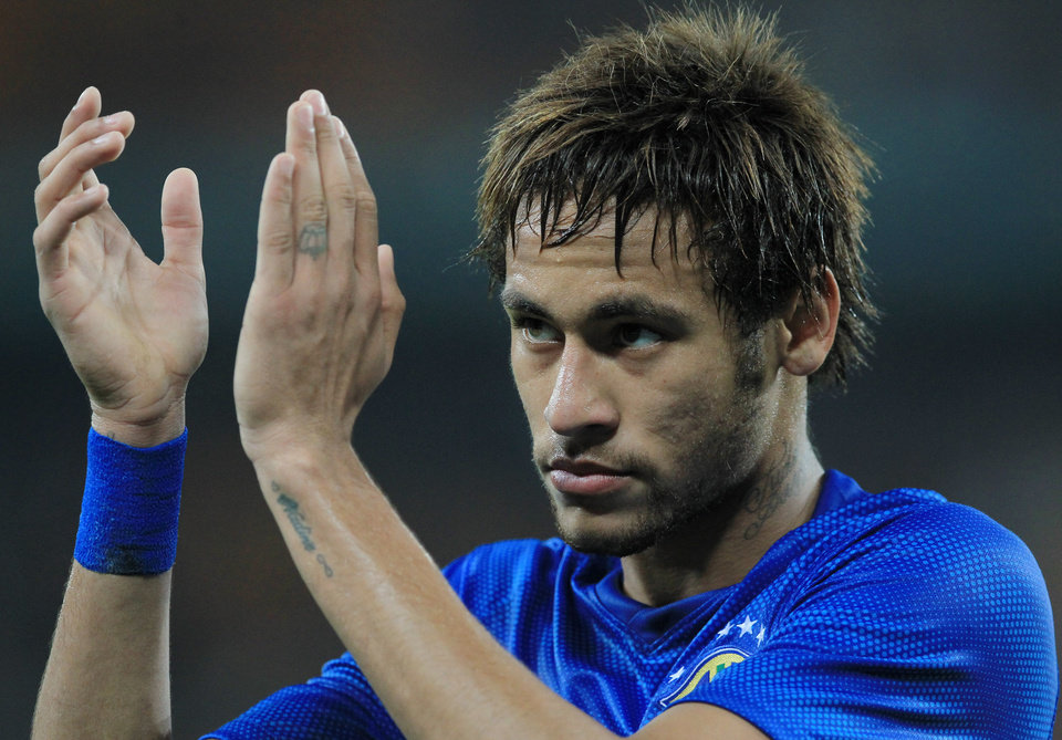 Photo - Brazil's Neymar, acknowledges fans during their international friendly soccer match against South Africa during their international friendly soccer match at Soccer City Stadium in Johannesburg, South Africa, Wednesday, March 5, 2014. Brazil beat South Africa 5-0. (AP Photo/Themba Hadebe)