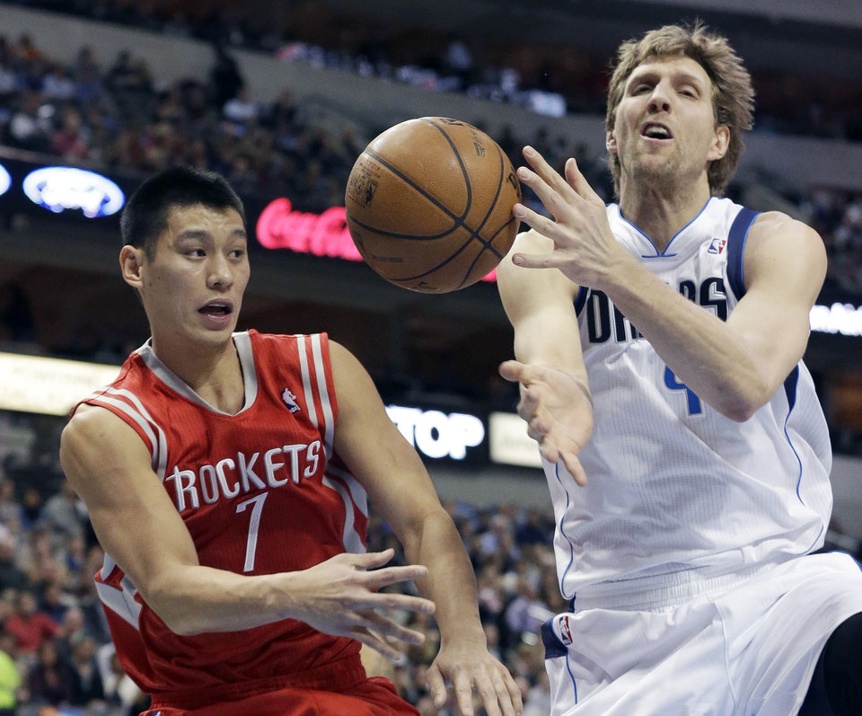 Photo - Houston Rockets point guard Jeremy Lin (7) pass off the ball against Dallas Mavericks forward Dirk Nowitzki, of Germany, during the first half of an NBA basketball game Wednesday, Jan. 29, 2014, in Dallas. (AP Photo/LM Otero)