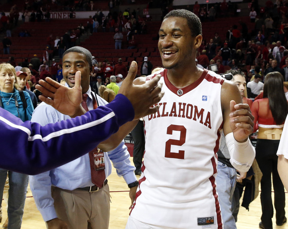 Oklahoma\'s Steven Pledger (2) greets fans as the University of Oklahoma Sooners (OU) defeat the Kansas Jayhawks (KU) 72-66 in NCAA, men\'s college basketball at The Lloyd Noble Center on Saturday, Feb. 9, 2013 in Norman, Okla. Photo by Steve Sisney, The Oklahoman
