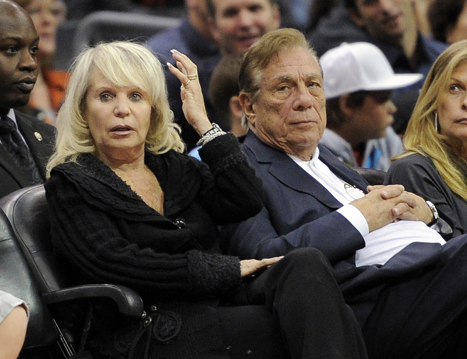 Photo - FILE - In this Nov. 12, 2010, file photo, Shelly Sterling sits with her husband, Donald Sterling, right, during the Los Angeles Clippers' NBA basketball game against the Detroit Pistons in Los Angeles. With a $2 billion sale of the Clippers hanging in the balance, a judge is set to determine Monday, June 30, 2014, if the terms of a family trust alone are enough to confirm Donald Sterling was properly removed as trustee and allow his estranged wife to sell the team without his consent. (AP Photo/Mark J. Terrill, File)