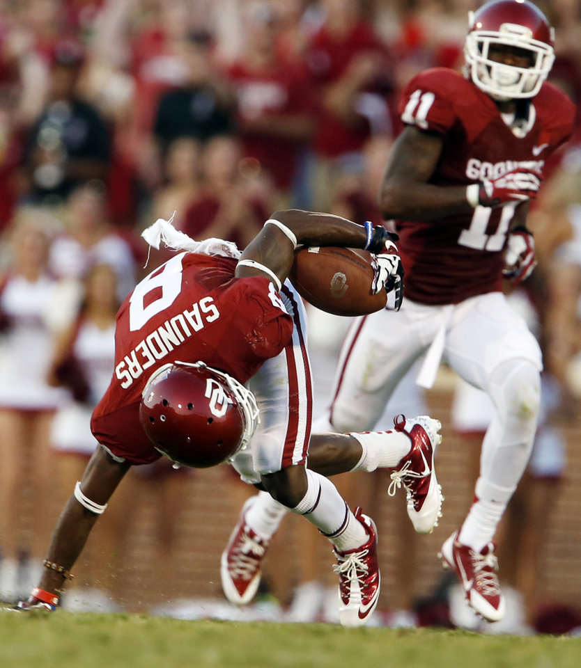 Oklahoma's Jalen Saunders (8) makes an acrobatic catch that stood up to a review during a college football game between the University of Oklahoma Sooners (OU) and the West Virginia University Mountaineers at Gaylord Family-Oklahoma Memorial Stadium in Norman, Okla., on Saturday, Sept. 7, 2013. Photo by Steve Sisney, The Oklahoman