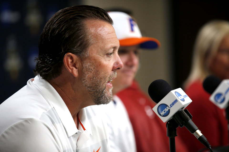 Photo - OSU coach Kenny Gajewski talks during media day at the Women's College World Series at the USA Softball Hall Of Fame Stadium in Oklahoma City, Wednesday, May 29, 2019.  [Sarah Phipps/The Oklahoman]