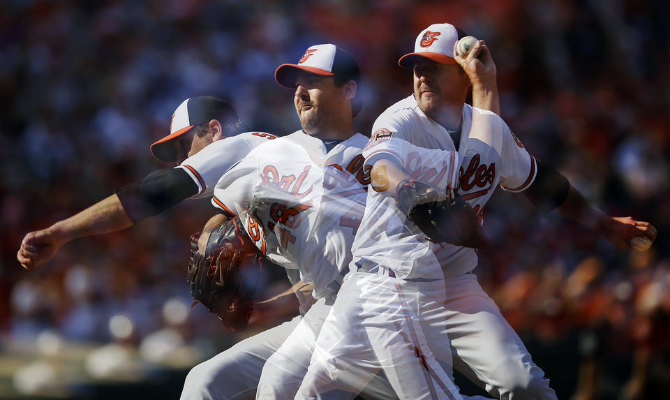 In this multiple exposure photo, Baltimore Orioles starting pitcher Joe Saunders throws to the Boston Red Sox in the seventh inning of a baseball game in Baltimore, Sunday, Sept. 30, 2012. (AP Photo/Patrick Semansky)