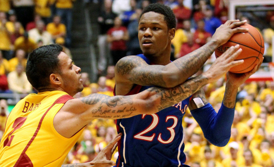 Iowa State guard Chris Babb (2) guards Kansas guard Ben McLemore (23) during the first half of an NCAA college basketball game, Monday, Feb. 25, 2013, in Ames, Iowa. (AP Photo/Justin Hayworth)