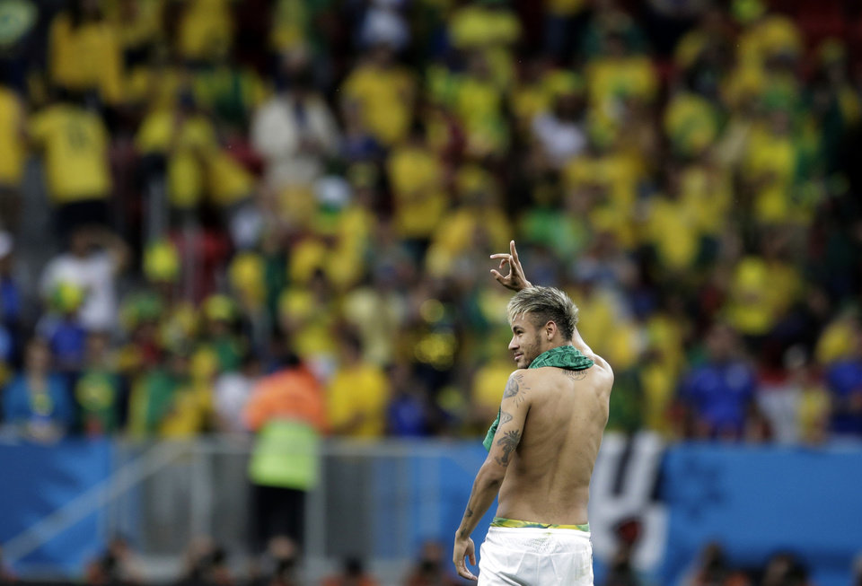 Photo - Brazil's Neymar waves to spectators following Brazil's 4-1 victory over Cameroon in the group A World Cup soccer match between Cameroon and Brazil at the Estadio Nacional in Brasilia, Brazil, Monday, June 23, 2014. (AP Photo/Bernat Armangue)
