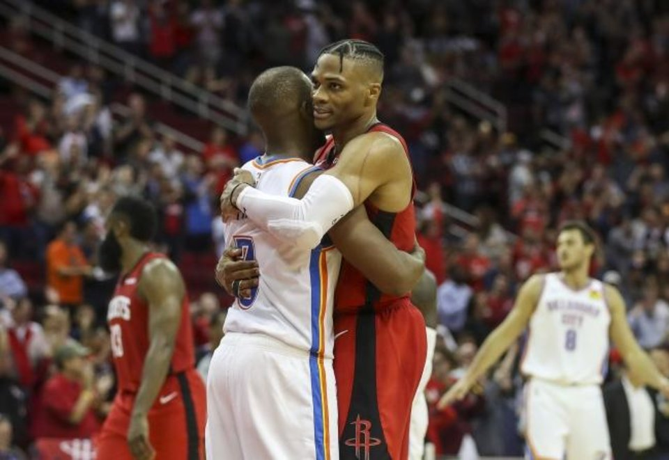 Photo -  Rockets guard Russell Westbrook (0) hugs the player he was traded for this summer, Thunder guard Chris Paul, after Houston's 116-112 win Monday. [Jon Shapley/Houston Chronicle]