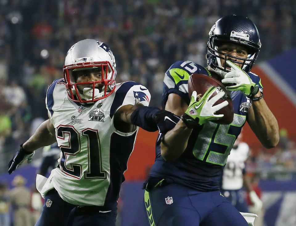 Photo - Seattle Seahawks wide receiver Jermaine Kearse (15) catches a pass in front of New England Patriots strong safety Malcolm Butler (21) during the second half of NFL Super Bowl XLIX football game Sunday, Feb. 1, 2015, in Glendale, Ariz. (AP Photo/Matt York)