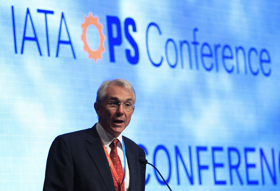 Photo - Chief Executive and Director General of the International Air Transport Association (IATA) Tony Tyler speaks during the IATA Ops Conference in Kuala Lumpur, Malaysia, Tuesday, April 1, 2014. The IATA said the disappearance of a Malaysia Airlines plane highlights the need for security improvements both in tracking aircraft and screening passengers before they board planes. The 3-week hunt for Flight 370 has turned up no confirmed sign of the Boeing 777, which disappeared March 8 with 239 people on board bound for Beijing from Kuala Lumpur. (AP Photo/Lai Seng Sin)