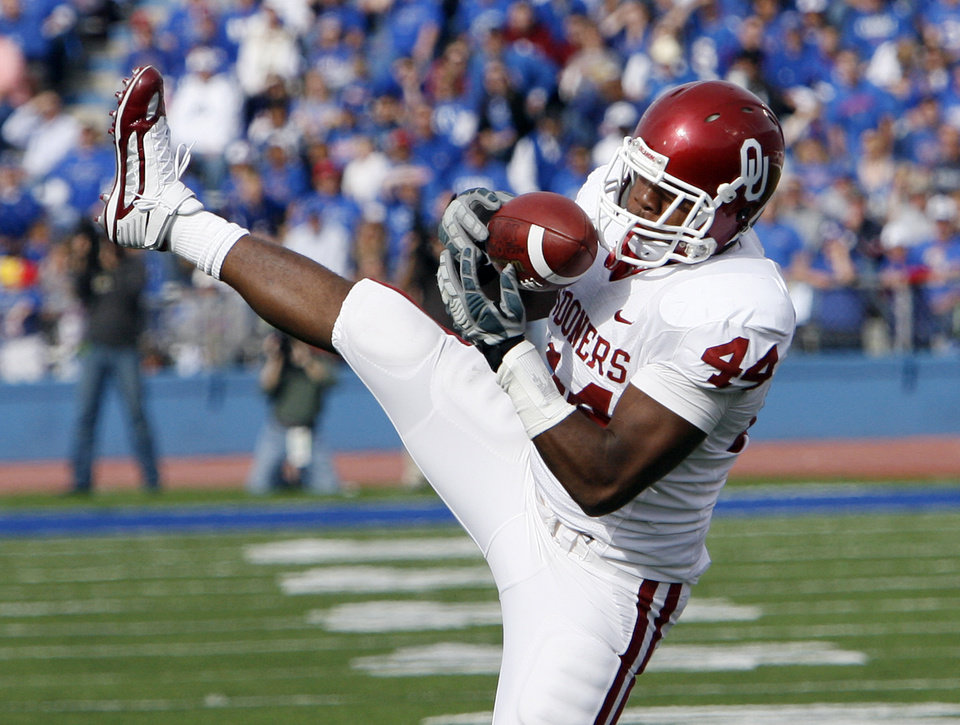 Photo - Jeremy Beal (44) make an interception against Kansas during the first half of the college football game between the University of Oklahoma Sooners (OU) and the University of Kansas Jayhawks (KU) on Saturday, Oct. 24, 2009, in Lawrence, Kan. Photo by Chris Landsberger, The Oklahoman