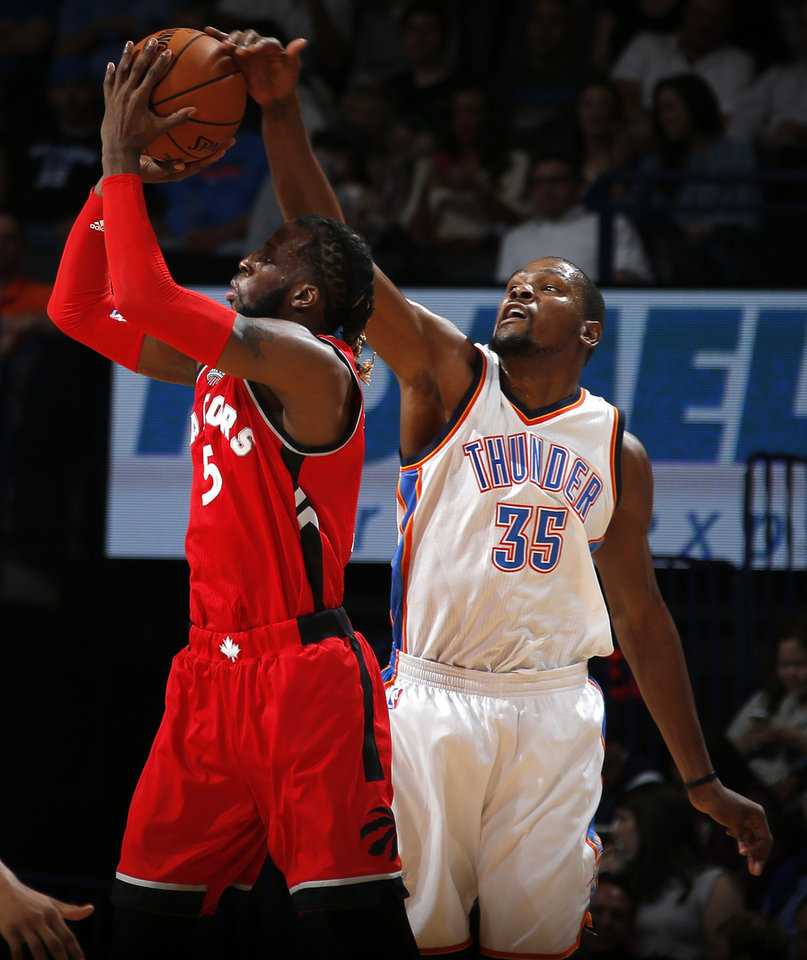 Photo - Oklahoma City's Kevin Durant (35) blocks the shot of Toronto's DeMarre Carroll (5) during an NBA basketball game between the Oklahoma City Thunder and the Toronto Raptors at Chesapeake Energy Arena on Wednesday, Nov. 4, 2015. Photo by Bryan Terry, The Oklahoman