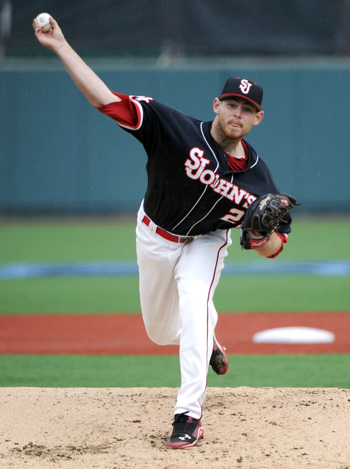 Photo - St. John's pitcher Ryan McCormick delivers the ball to Xavier during the first inning of an NCAA college baseball game in the Big East tournament Friday, May 23, 2014, in New York. McCormick got the loss as Xavier defeated St. John's 8-2. (AP Photo/Bill Kostroun)