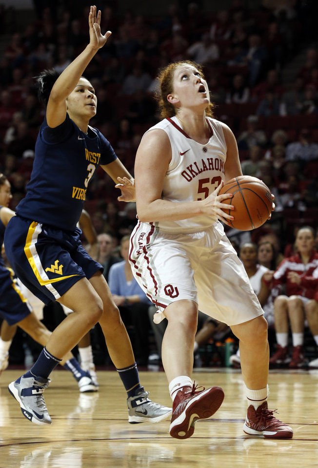 Oklahoma Sooner's Joanna McFarland (53) shoots in front of West Virginia Mountaineers' Akilah Bethel (3) during the second half as the University of Oklahoma Sooners (OU) defeat the West Virginia Mountaineers 71-68 in NCAA, women's college basketball at The Lloyd Noble Center on Wednesday, Jan. 2, 2013  in Norman, Okla. Photo by Steve Sisney, The Oklahoman