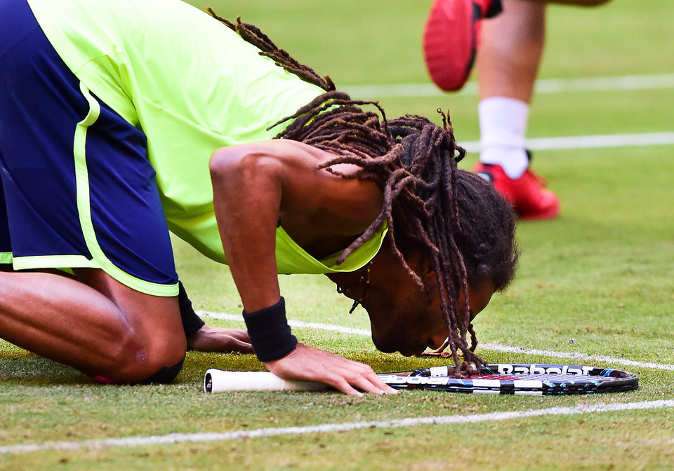 Photo - Germany's Dustin Brown celebrates his victory against Spain's Rafael Nadal during the Gerry Weber Open tennis tournament in Halle, Germany, Thursday, June 12, 2014. Brown won the match with 6-4 and 6-1. (AP Photo/dpa,Christian Weische)