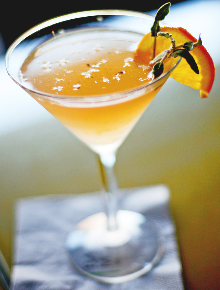 "The ""Sage Signature Drink:"" Absolut Mango, orange liqueur and cranberry juice muddled with fresh fruit and sage. PHOTO BY BRYAN TERRY, THE OKLAHOMAN"