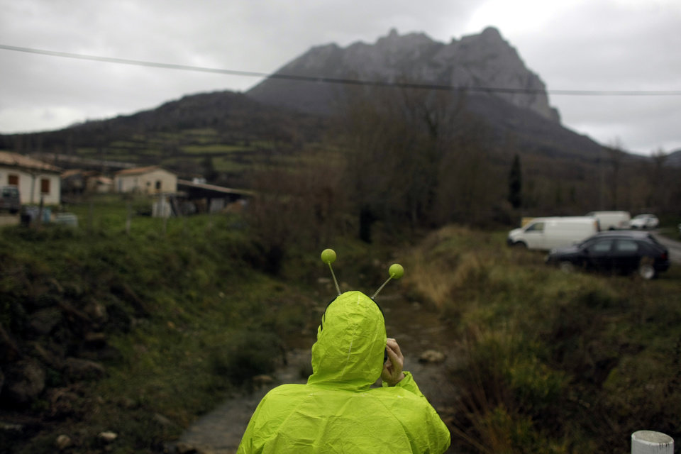Photo - A woman dressed in an alien costume attends a small party in the town of Bugarach, France, Friday, Dec. 21, 2012. Although the long expected end of the Mayan calendar has come, the New Age enthusiasts have steered clear from the sleepy French town of Bugarach, which gave some locals a chance to joke about the UFO legends that surround the area. (AP Photo/Marko Drobnjakovic)