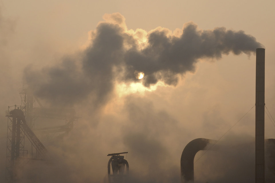 Photo - FILE - In this  Jan. 17, 2013 file photo, smoke is emitted from chimneys of a cement plant in Binzhou city, in eastern China's Shandong province. President Barack Obama's proposal to curb U.S. greenhouse gas emissions might improve the chances of completing a global climate treaty but is unlikely to defuse demands by China, India and others for Americans to do more. China, the biggest emitter, has promised to curb its output but with its economy slowing, and communist leaders under pressure to generate jobs, has resisted binding limits. (AP Photo/File)  CHINA OUT