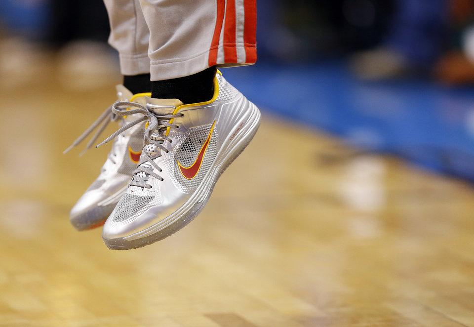 Houston\'s James Harden (13) warms up wearing silver shoes before Game 2 in the first round of the NBA playoffs between the Oklahoma City Thunder and the Houston Rockets at Chesapeake Energy Arena in Oklahoma City, Wednesday, April 24, 2013. Photo by Nate Billings, The Oklahoman